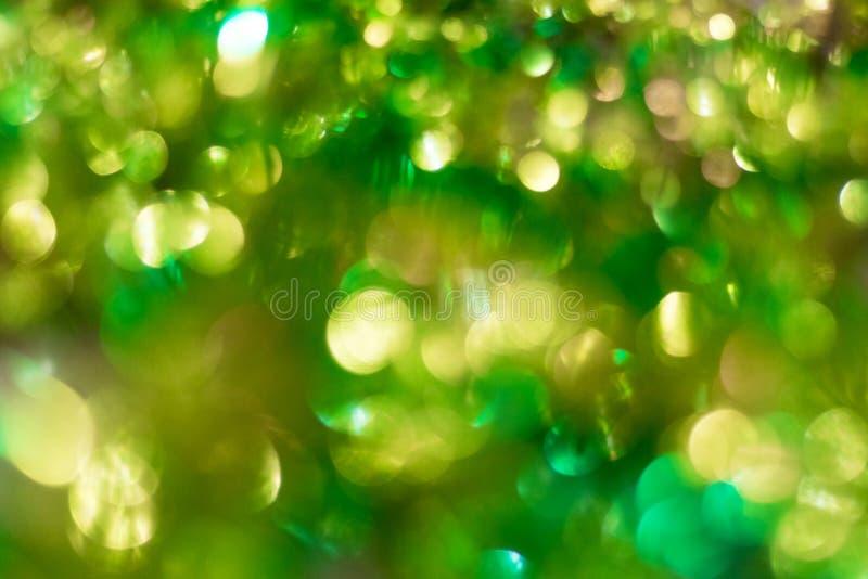 Fondo verde del extracto del Año Nuevo con el side_ de oro brillante fotos de archivo