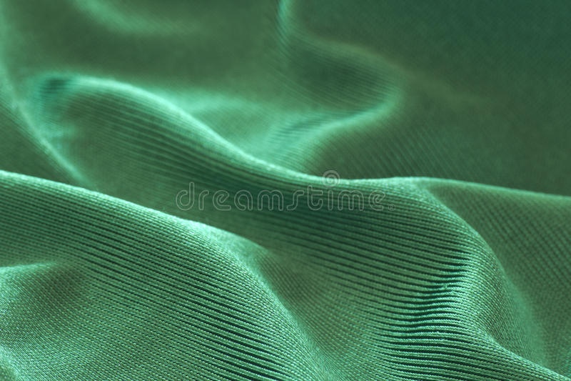 Fondo verde del tessuto fotografie stock