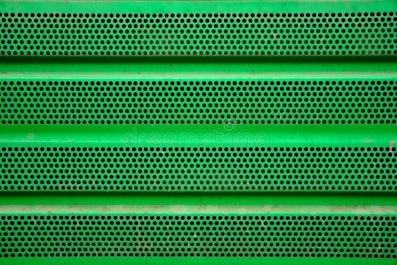 Fondo verde della griglia del metallo, rivestimento del ferro immagine stock