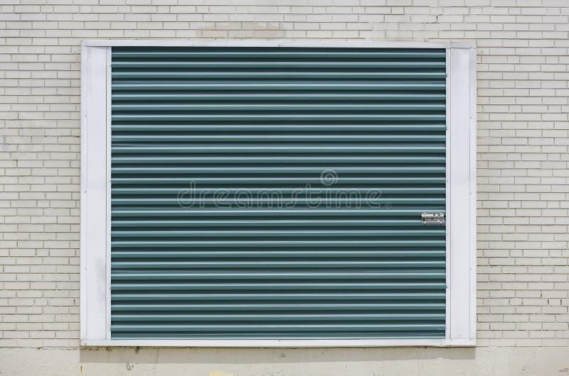 Fondo verde della porta dell'unità di stoccaggio immagine stock libera da diritti