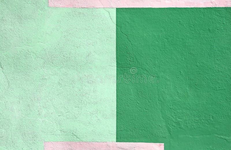 Fondo verde multicolor coloreado de la pintura de la pared imágenes de archivo libres de regalías