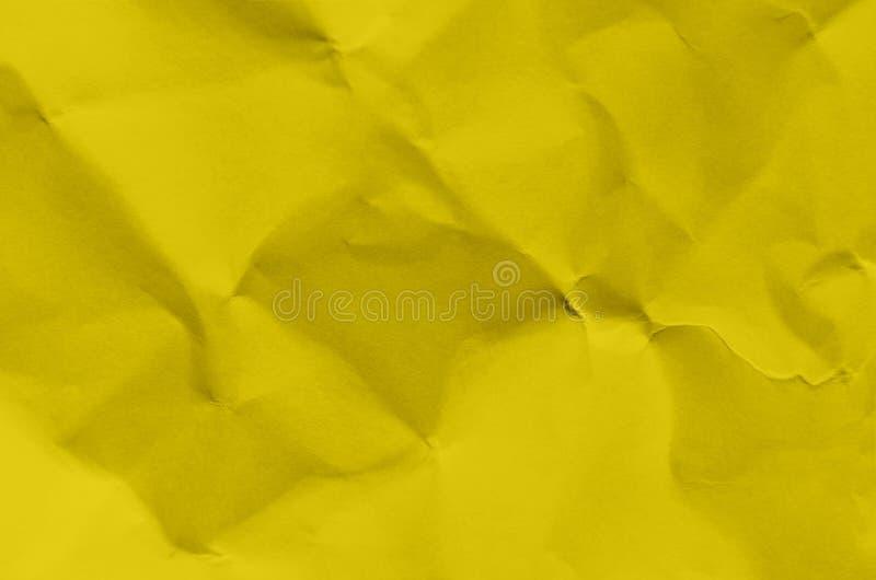 Fondo y papel pintado amarillos por textura y el franco de papel arrugados fotos de archivo libres de regalías
