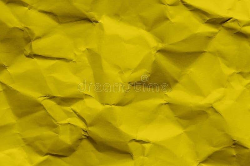 Fondo y papel pintado amarillos por textura y el franco de papel arrugados imágenes de archivo libres de regalías