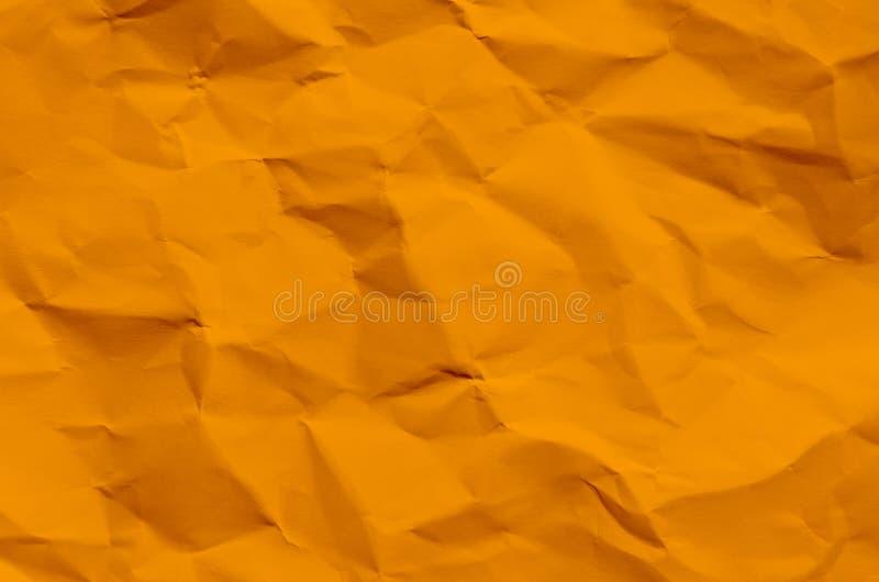 Fondo y papel pintado anaranjados por textura y el franco de papel arrugados fotografía de archivo