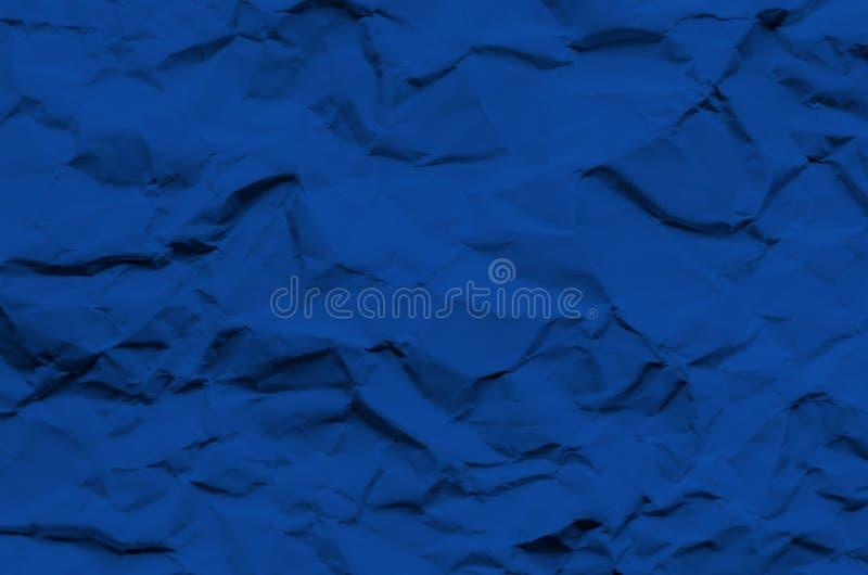 Fondo y papel pintado azules profundos por textura de papel arrugada y fotografía de archivo