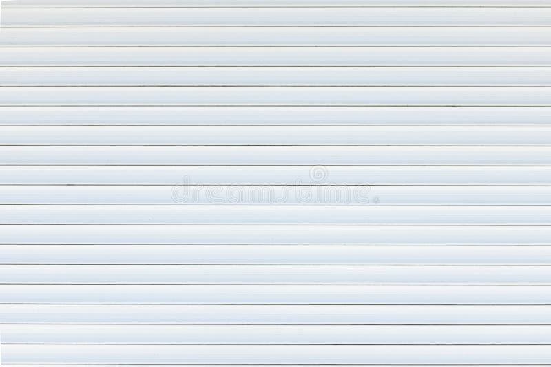 Fondo y textura del obturador de la puerta del rodillo del metal blanco fotos de archivo libres de regalías