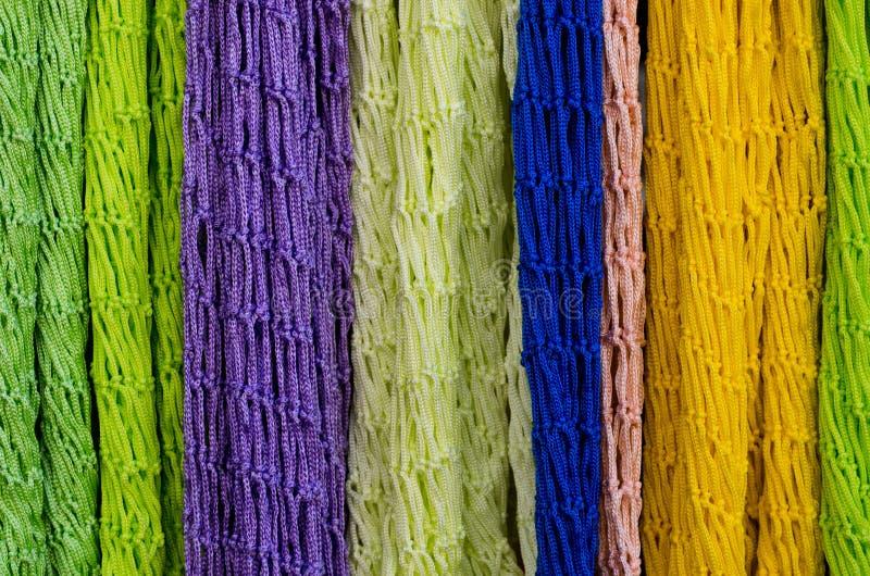 Fondo y texturas coloridos de la materia textil anudada fotografía de archivo