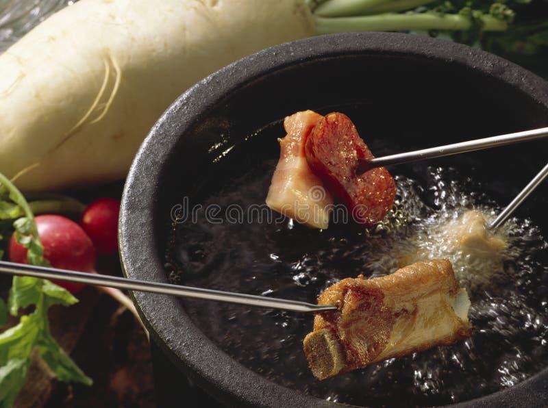 Fondue de viande photo stock