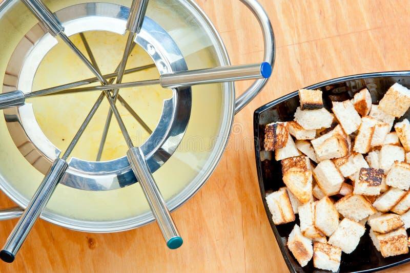 Fondue en croutons stock afbeelding
