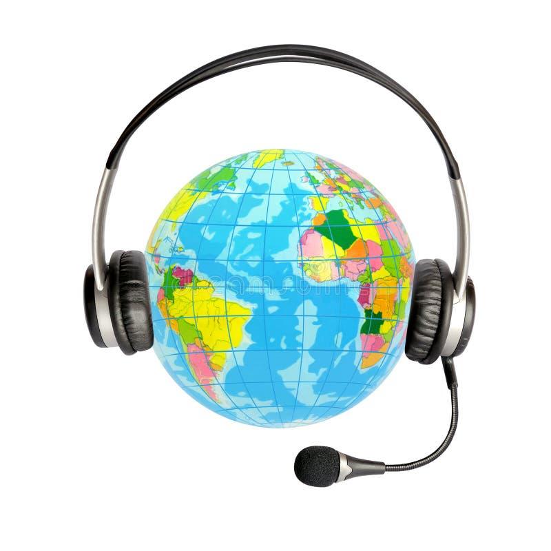 Fones de ouvido com um microfone e um globo imagens de stock