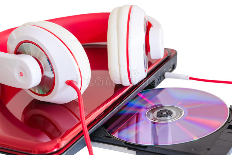 Fones de ouvido e portátil vermelhos com disco compacto imagens de stock royalty free