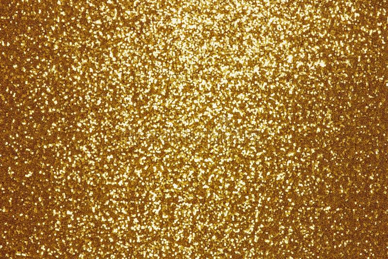 Fonkelende gouden lovertje textielachtergrond stock afbeelding
