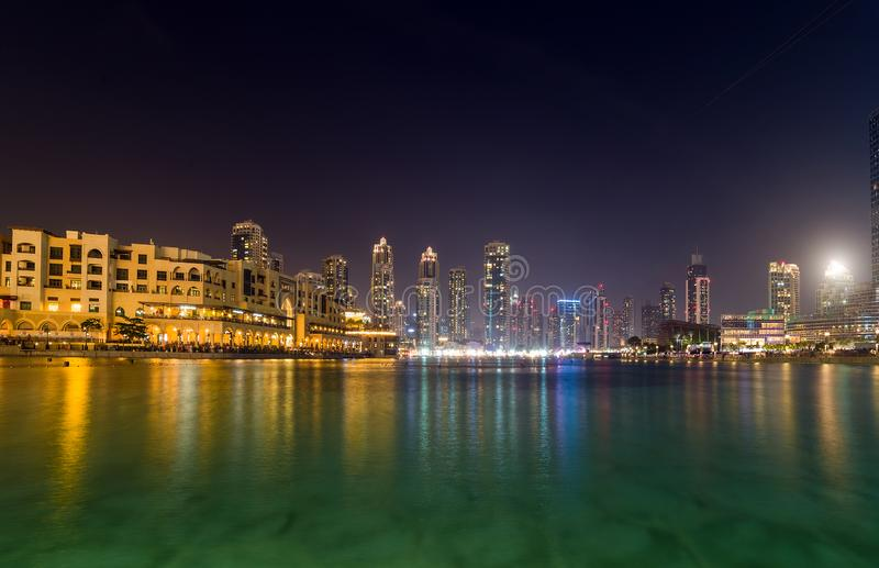 Fontaines evening show near Dubai mall, UAE. Dubai Fountain Show and Burj Lake, horizontal frame lakes waterfront illuminations, fontaines evening show near stock images