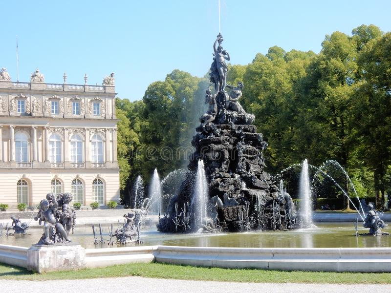 Palace of Herrenchiemsee - Fontains with romantic sculpture - Bavarian Versailles – Germany. Royal Palace Herrenchiemsee - Fontains with romantic royalty free stock image