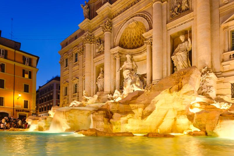 The Fontana di Trevi in Rome illuminated at night. ROME,ITALY - JULY 19,2017 : The Fontana di Trevi in Rome illuminated at night stock photos