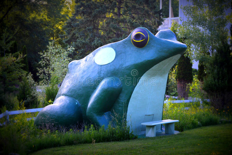Fontana's Frog Landmark. An iconic 14 foot frog structure in Fontana, WI. The concrete structure is a lone remnant of Frog Hollow, a fireworks store and stock image