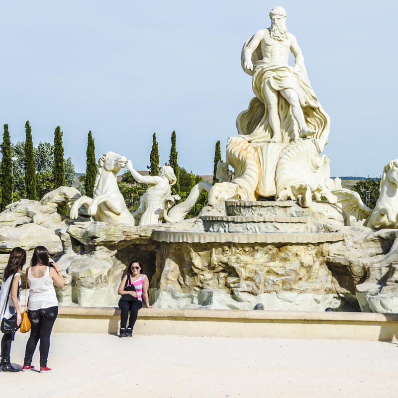 Fontana. Torrejon de Ardoz. Madrid. Spain. May 11 2014. Reproduction of the Fontana di Trevi in Madrid. Visitors are portrayed under the watchful eye of God royalty free stock photo