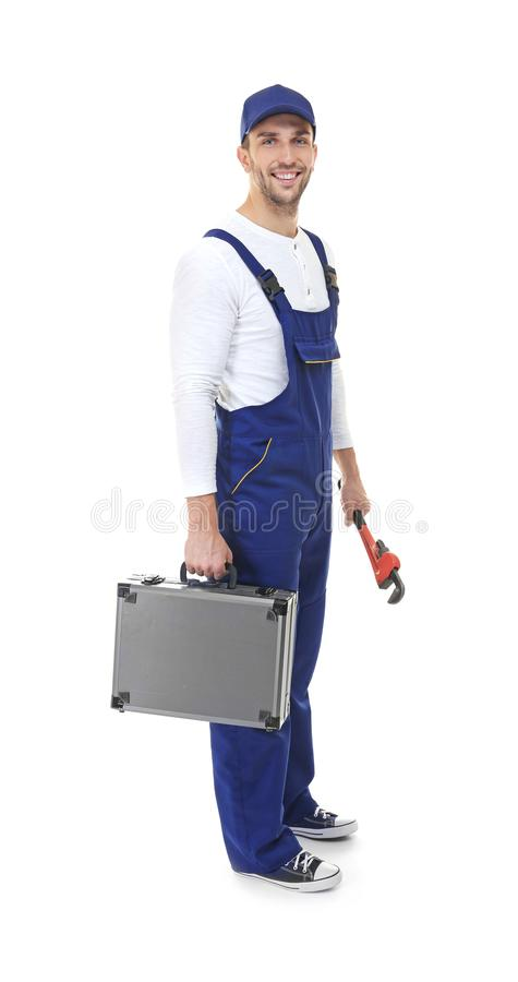 Fontanero en uniforme del azul con la tornillo-llave foto de archivo libre de regalías