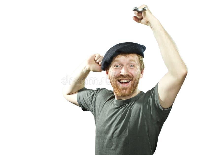 Fontanero eufórico en sombrero con la barba roja fotos de archivo