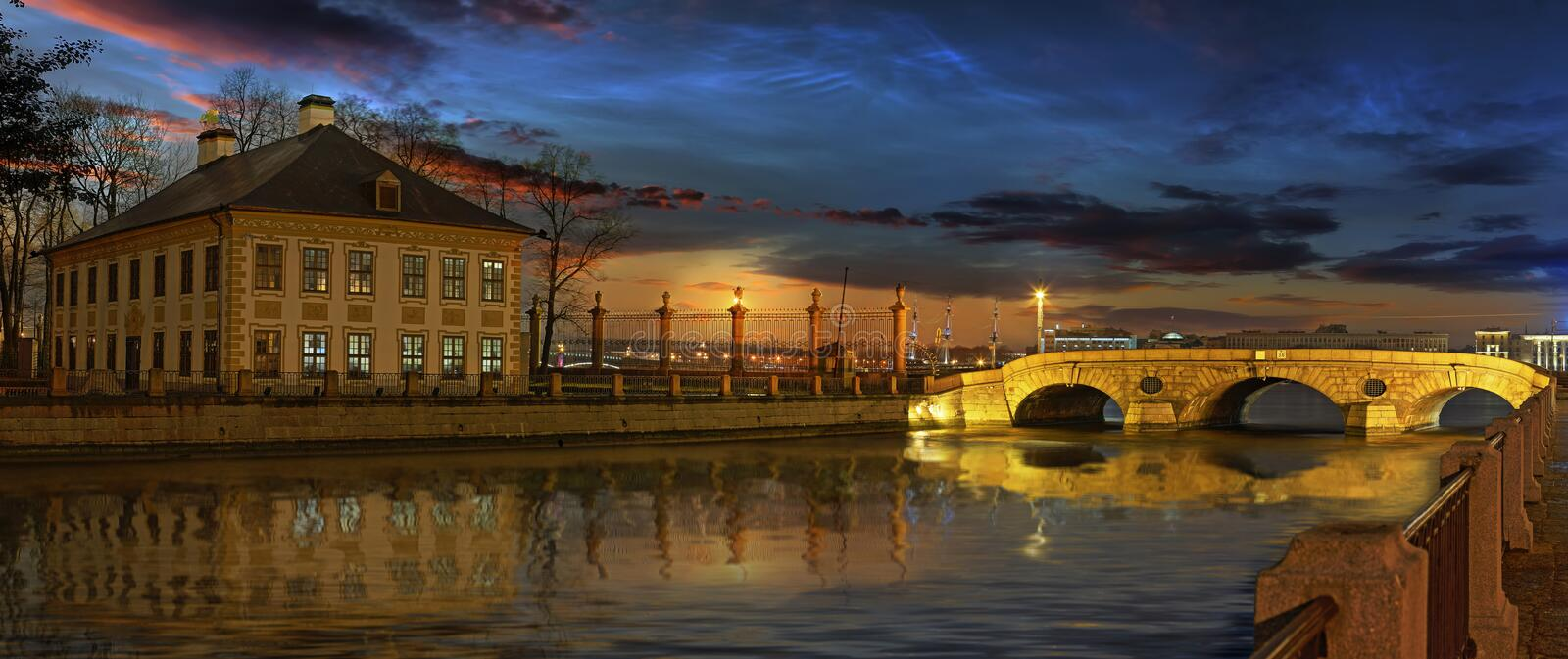 The Fontanka river and the summer Palace of Peter the great in S stock photos