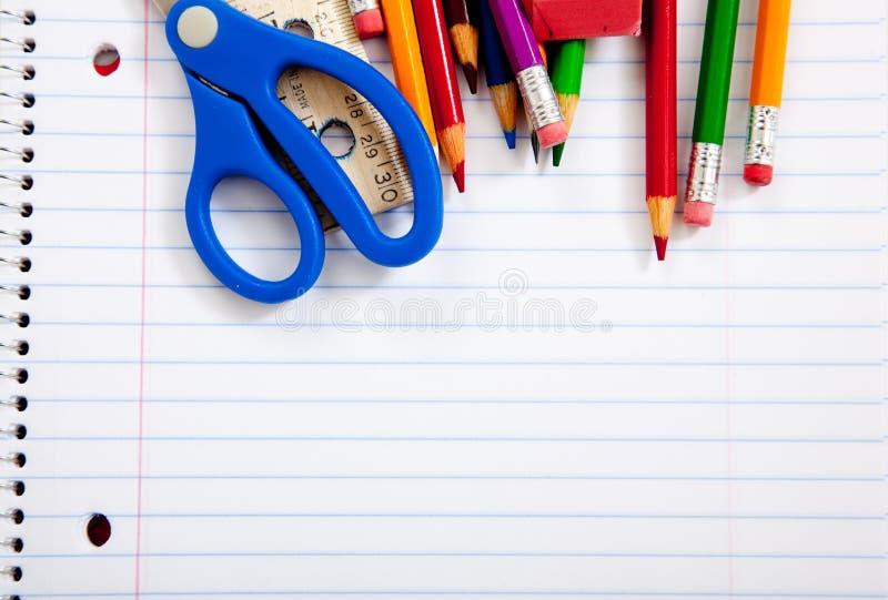 Fontes de escola Assorted com cadernos fotos de stock royalty free