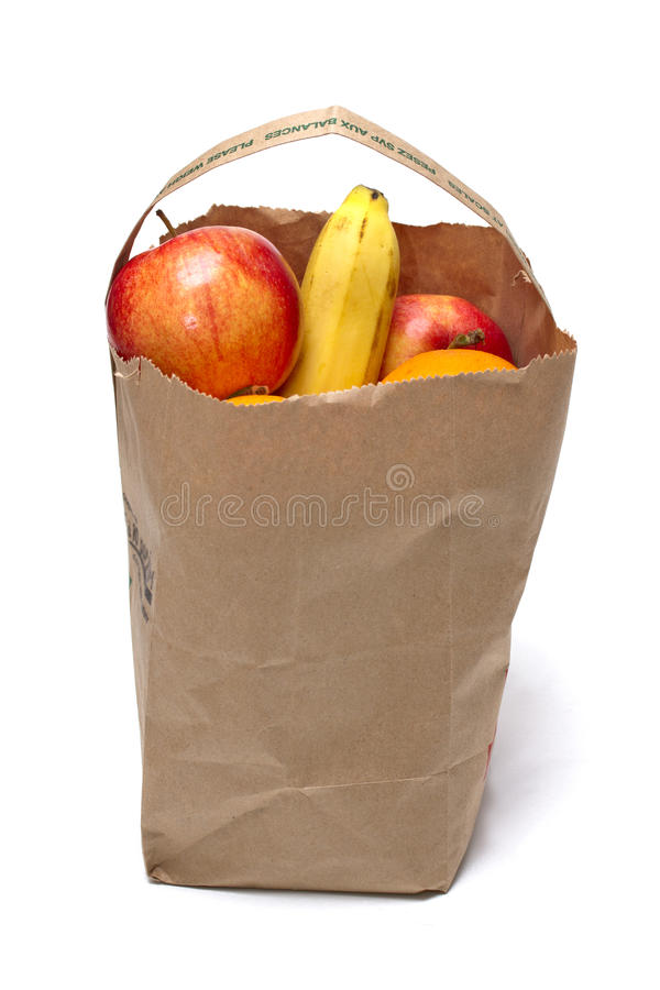 Food. Grocery bag of food: fruits and groceries on background royalty free stock photo