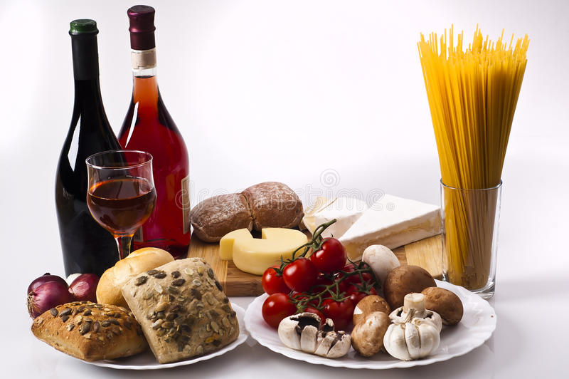 Food. Table food. Mix of vegetables, bread, cheese and wine on a white background stock photo