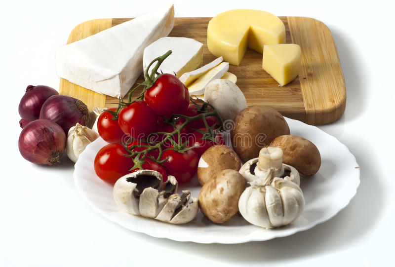 Food. Products, cheese and vegetables isolated on white background royalty free stock image