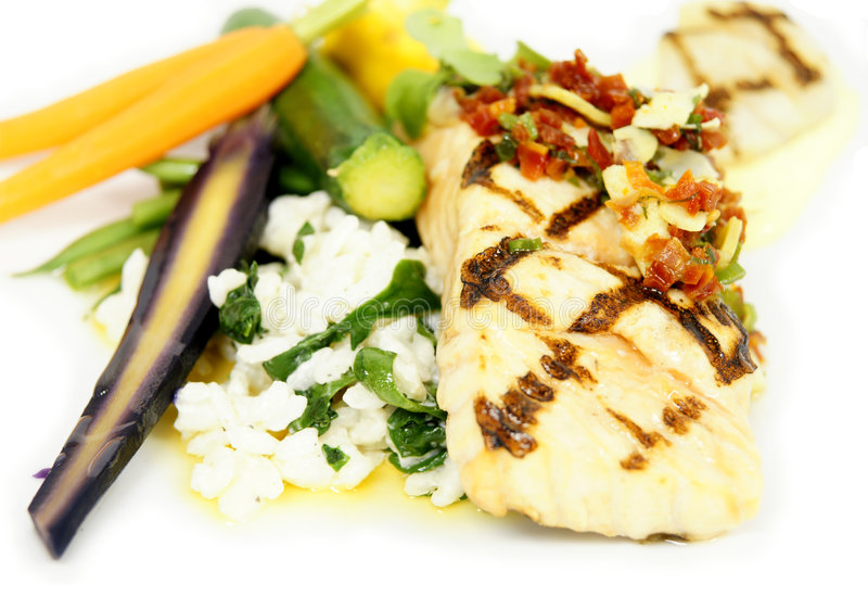 Food. Health and delicious fish and vegetables food royalty free stock photography
