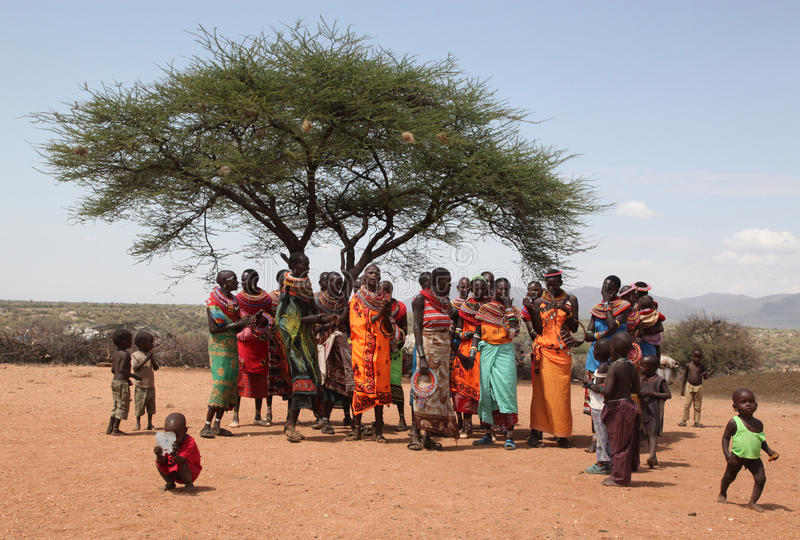 Food aid. Women queing and waiting for food donations in East Africa