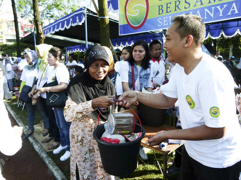 Food aid. Poor people receive food aid from non-governmental organizations in the city of Solo, Central Java, Indonesia stock photo