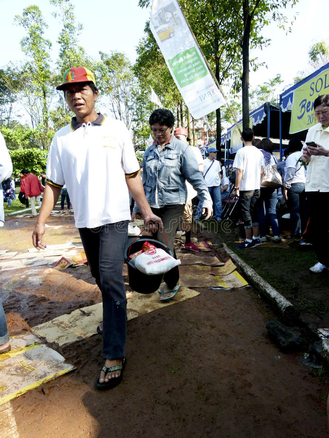 Food aid. Poor people receive food aid from non-governmental organizations in the city of Solo, Central Java, Indonesia stock photos
