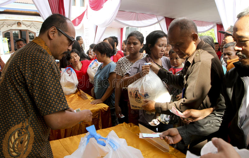 Food aid. The poor received food aid in the city of Solo, Central Java, Indonesia stock photography