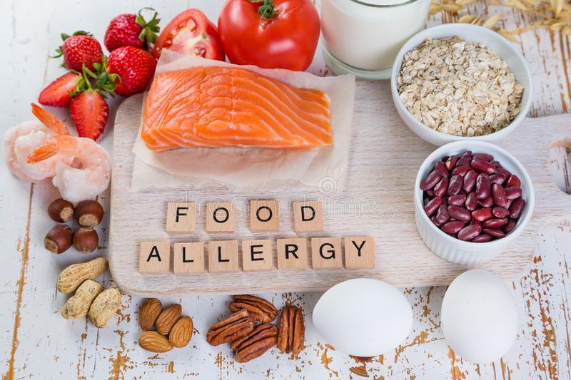 Food allergies - food concept with major allergens. Rustic wood background stock photos