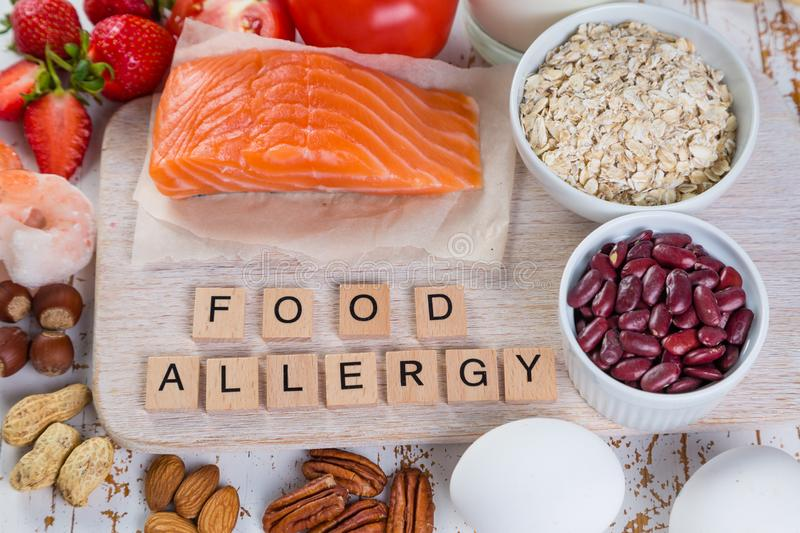 Food allergies - food concept with major allergens. Rustic wood background royalty free stock photos