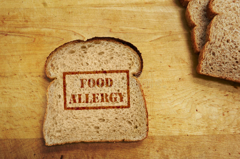 Food allergy concept. Slice of bread with Food Allergy text royalty free stock photography