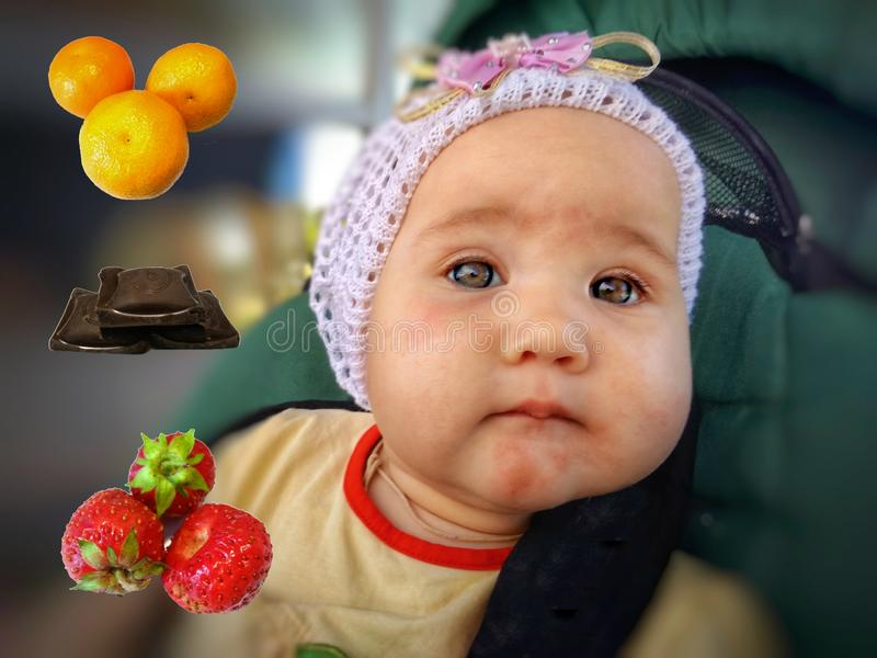Food Allergy in infants. Food Allergy in a baby. Red rash on his face. Food allergens on a blurred background royalty free stock photo