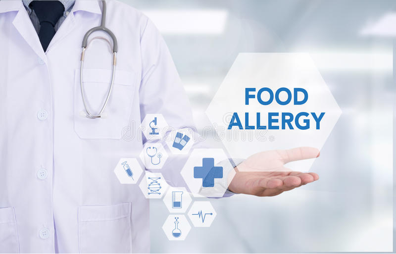 FOOD ALLERGY. Medicine doctor hand working Professional doctor use computer and medical equipment all around, desktop top view royalty free stock images
