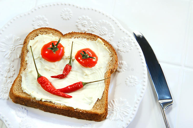 Food arranged into a smiley face royalty free stock photo