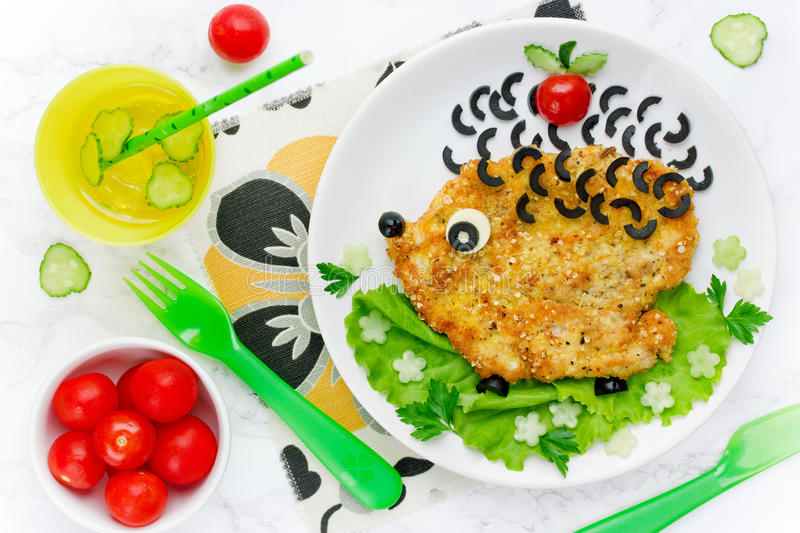 Food art idea for kids lunch - chicken schnitzel with vegetables stock photos