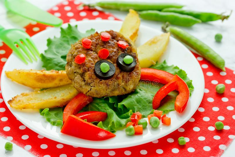 Food art idea for kids lunch - meatball with fried potato stock photos