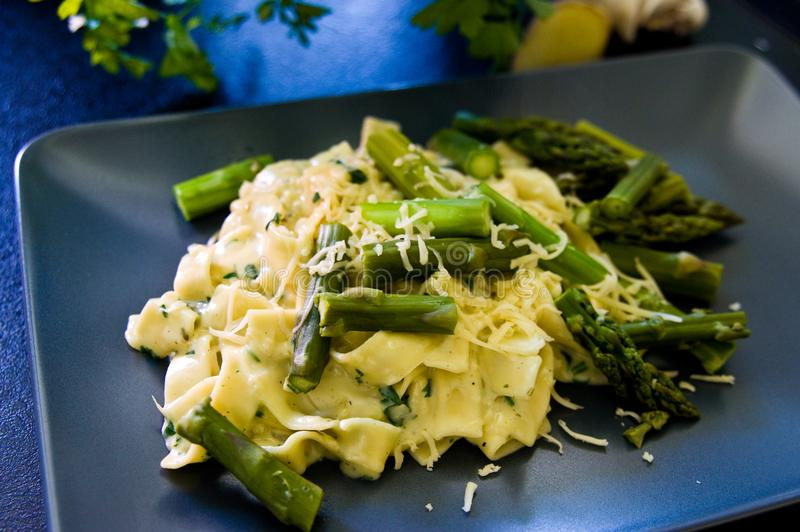 Food asparagus with italian pasta and cheese royalty free stock image