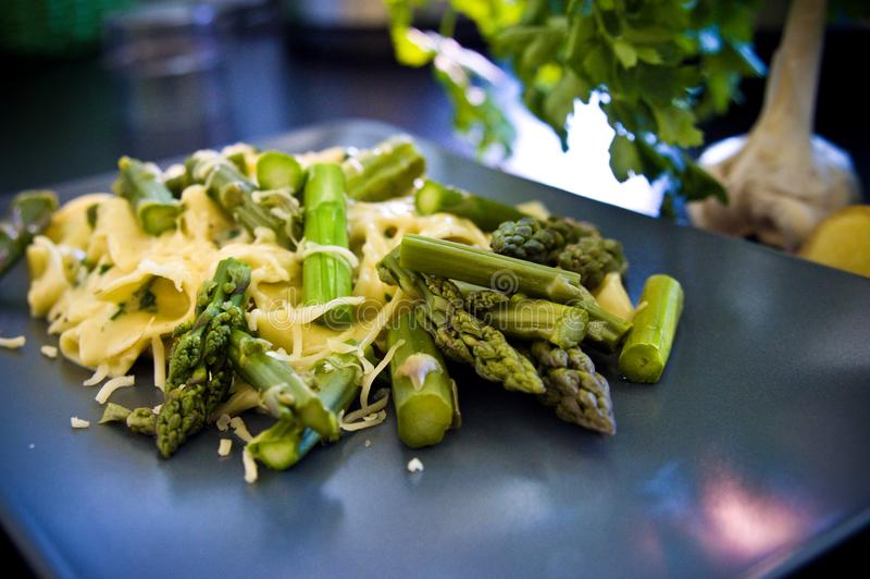 Food asparagus with italian pasta and cheese royalty free stock photography