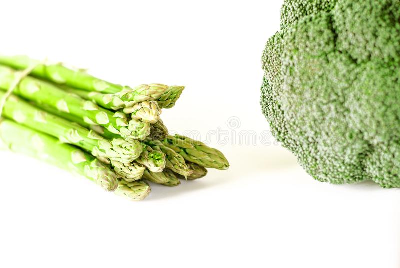 Food background asparagus and broccoli flat lay pattern. bunch of fresh green asparagus on white background, top view stock image