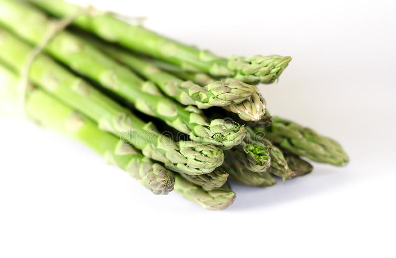 Food background asparagus flat lay pattern. bunch of fresh green asparagus on white background, top view royalty free stock images