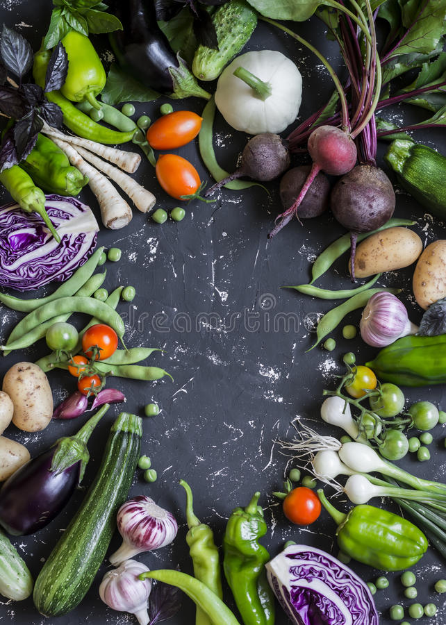 Food background. Assortment of fresh garden vegetables. Top view. Free space for text stock photo