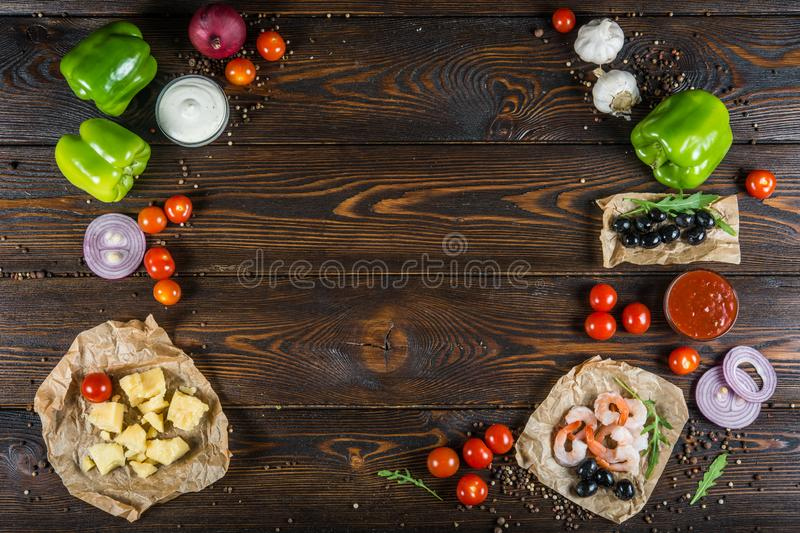 Food background design. Frame of seafood, shrimps and olives on royalty free stock photo