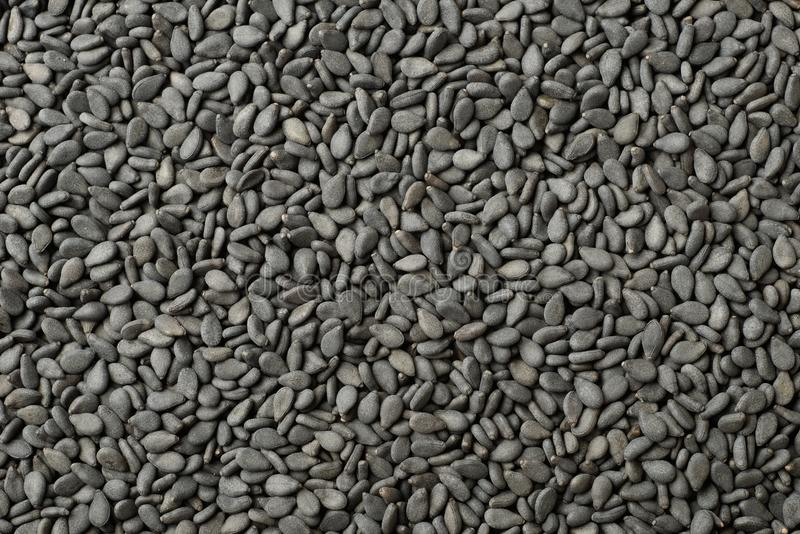 Food background of black sesame seeds, top view stock photo