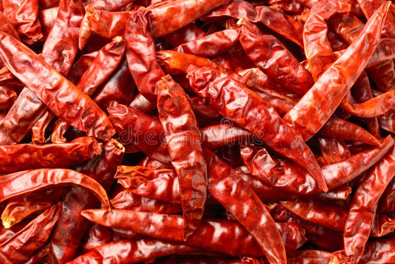 Food background of dried red chilies, top view stock photos