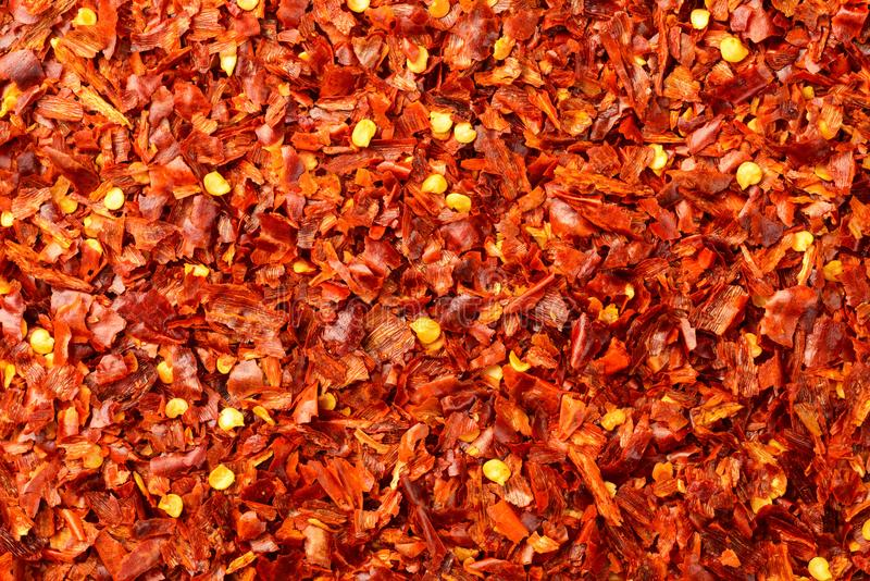 Food background of dried red pepper flakes, top view stock photos